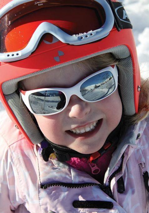 Happy child skiing in samoens